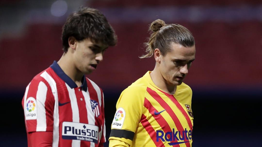L'attaquant portugais Joao Félix de l'Atletico Madrid (à gauche) et l'attaquant français Antoine Griezmann du FC Barcelone (à droite)