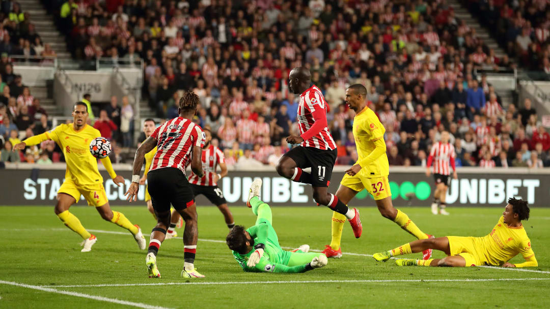 Yoane Wissa (right of centre) somehow managed to keep a cool head among the boiling intensity to equalise for Brentford against Liverpool