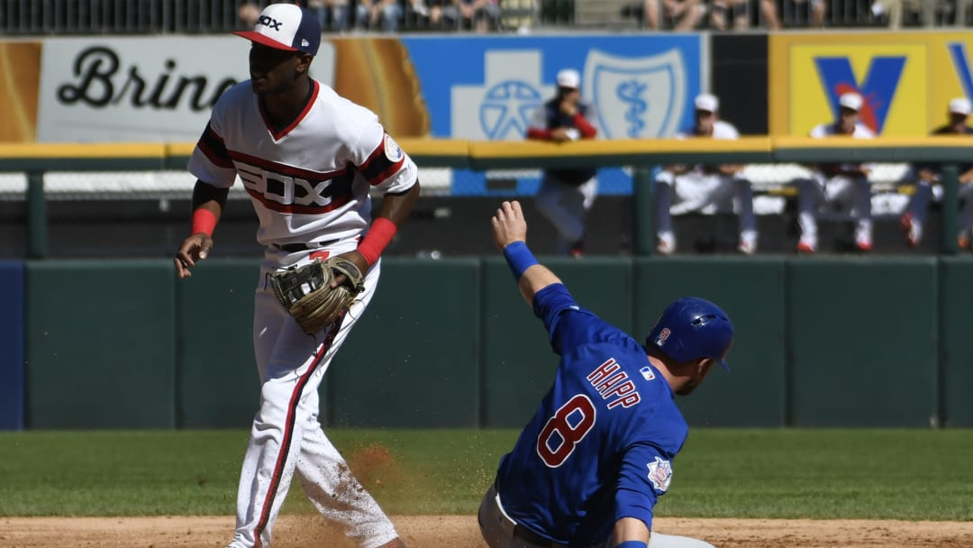 CHICAGO, IL - SEPTEMBER 23: Ian Happ #8 of the Chicago Cubs steals second base as Tim Anderson #7 of the Chicago White Sox stands nearby during the third inning on September 23, 2018 at Guaranteed Rate Field  in Chicago, Illinois. (Photo by David Banks/Getty Images)