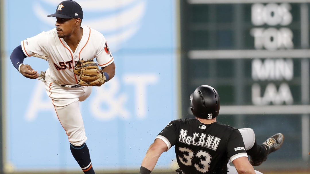 HOUSTON, TX - MAY 23:  James McCann #33 of the Chicago White Sox steals second as Tony Kemp #18 of the Houston Astros fields the throw in the seventh inning at Minute Maid Park on May 23, 2019 in Houston, Texas.  (Photo by Tim Warner/Getty Images)
