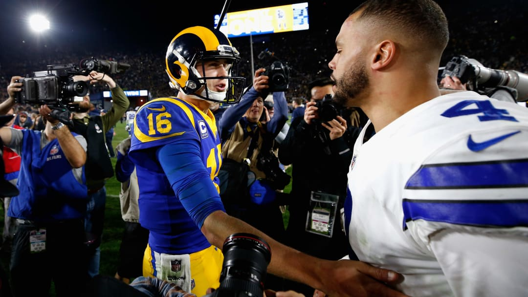 LOS ANGELES, CA - JANUARY 12:  Jared Goff #16 of the Los Angeles Rams greets Dak Prescott #4 of the Dallas Cowboys after the NFC Divisional Playoff game at Los Angeles Memorial Coliseum on January 12, 2019 in Los Angeles, California. The Rams defeated the Cowboys 30-22.  (Photo by Sean M. Haffey/Getty Images)
