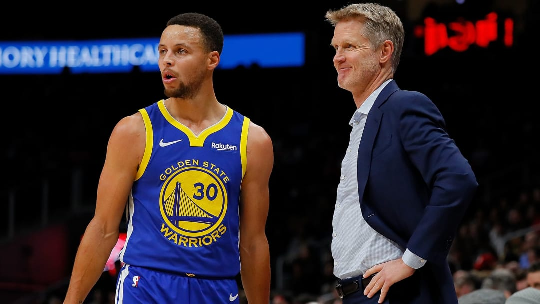 Golden State Warriors point guard Steph Curry and head coach Steve Kerr
