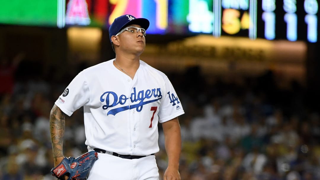 LOS ANGELES, CALIFORNIA - JULY 23:  Julio Urias #7 of the Los Angeles Dodgers reacts to a Kole Calhoun #56 of the Los Angeles Angels double, to score Justin Upton #8 for a 3-1 lead, during the fifth inning at Dodger Stadium on July 23, 2019 in Los Angeles, California. (Photo by Harry How/Getty Images)