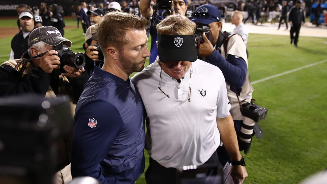 OAKLAND, CA - SEPTEMBER 10:  Head coach Sean McVay of the Los Angeles Rams and head coach Jon Gruden of the Oakland Raiders speak following the Rams win over the Raiders at Oakland-Alameda County Coliseum on September 10, 2018 in Oakland, California.  (Photo by Ezra Shaw/Getty Images)
