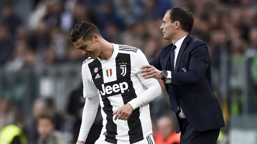 Massimiliano Allegri (R), head coach of Juventus FC, holds...