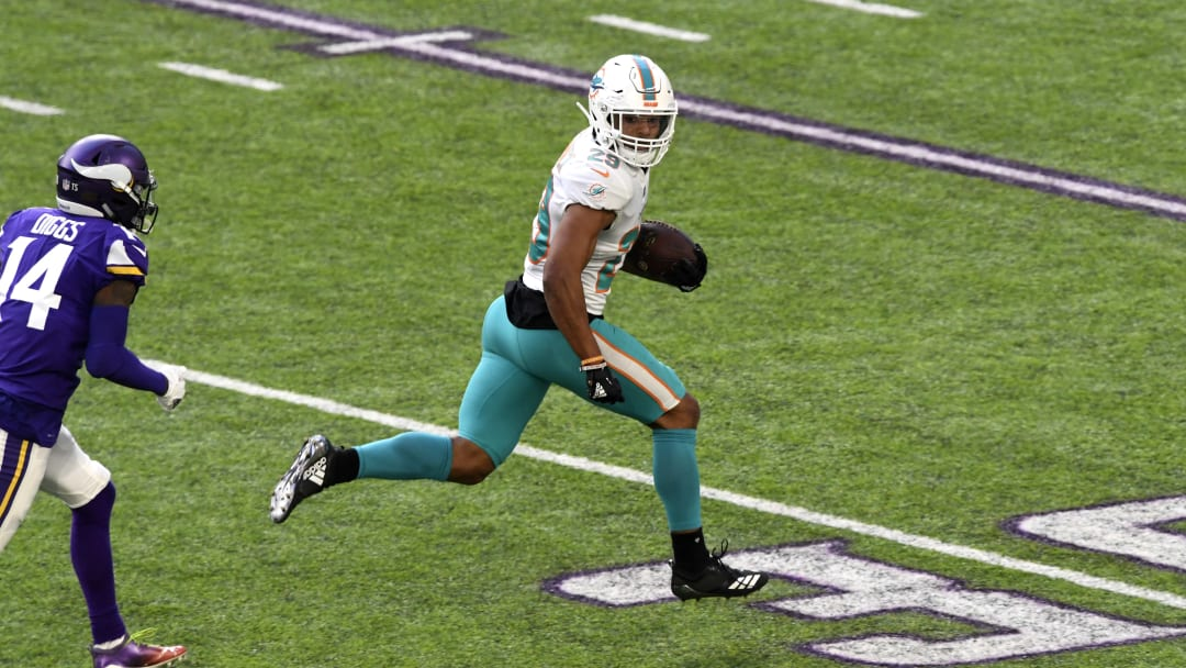MINNEAPOLIS, MN - DECEMBER 16: Minkah Fitzpatrick #29 of the Miami Dolphins runs with the ball after intercepting a pass by Kirk Cousins #8 of the Minnesota Vikings in the second quarter of the game at U.S. Bank Stadium on December 16, 2018 in Minneapolis, Minnesota. Fitzpatrick scored a 50 yard touchdown on the play. (Photo by Hannah Foslien/Getty Images)