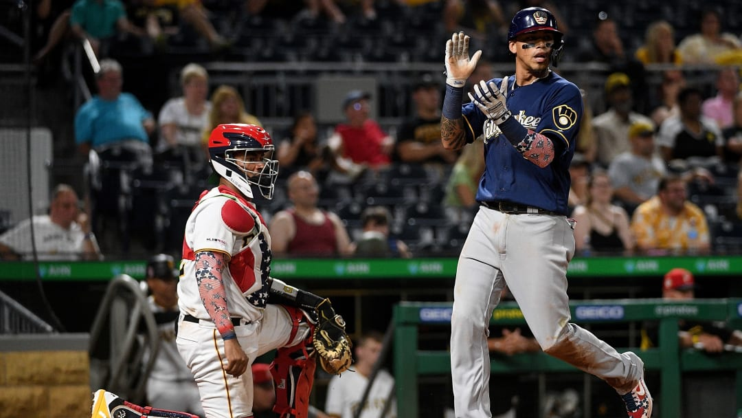 PITTSBURGH, PA - JULY 05: Orlando Arcia #3 of the Milwaukee Brewers comes around to score on an RBI single by Lorenzo Cain #6 in the tenth inning during the game against the Pittsburgh Pirates at PNC Park on July 5, 2019 in Pittsburgh, Pennsylvania. (Photo by Justin Berl/Getty Images)
