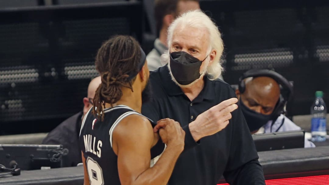 San Antonio Spurs Gregg Popovich, Patty Mills