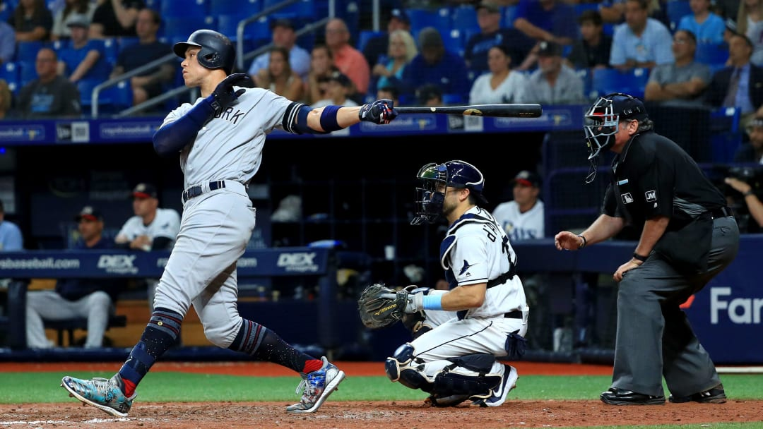 ST PETERSBURG, FLORIDA - JULY 05: Aaron Judge #99 of the New York Yankees hits a solo home run in the 11th inning during a game against the Tampa Bay Rays at Tropicana Field on July 05, 2019 in St Petersburg, Florida. (Photo by Mike Ehrmann/Getty Images)