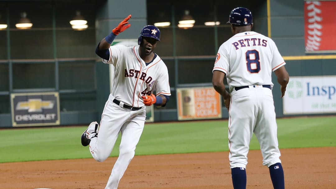 HOUSTON, TEXAS - SEPTEMBER 09: Yordan Alvarez #44 of the Houston Astros is congratulated by third base coach Gary Pettis #8 after hitting a home run in the first inning against the Oakland Athletics at Minute Maid Park on September 09, 2019 in Houston, Texas. (Photo by Bob Levey/Getty Images)