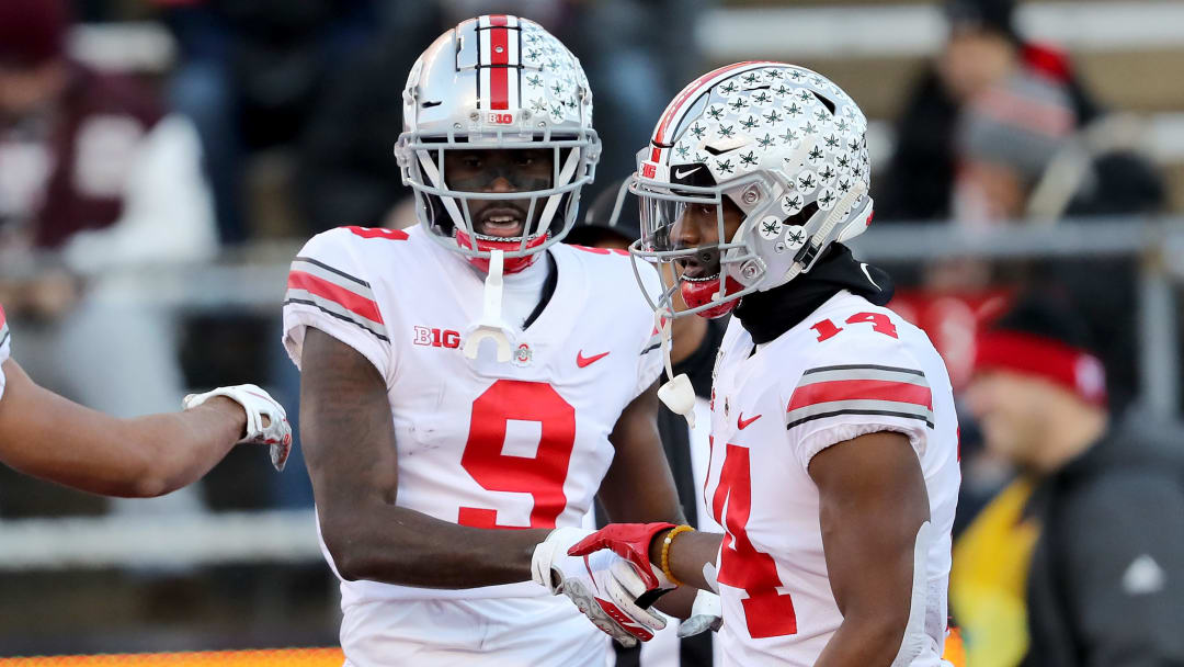 PISCATAWAY, NEW JERSEY - NOVEMBER 16:  Binjimen Victor #9 of the Ohio State Buckeyes celebrates his touchdown with teammate K.J. Hill #14 in the first quarter against the Rutgers Scarlet Knights at SHI Stadium on November 16, 2019 in Piscataway, New Jersey. (Photo by Elsa/Getty Images)