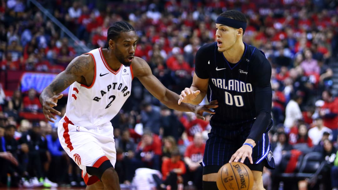 TORONTO, ON - APRIL 23:  Aaron Gordon #00 of the Orlando Magic dribbles the ball as Kawhi Leonard #2 of the Toronto Raptors defends during Game Five of the first round of the 2019 NBA Playoffs at Scotiabank Arena on April 23, 2019 in Toronto, Canada.  NOTE TO USER: User expressly acknowledges and agrees that, by downloading and or using this photograph, User is consenting to the terms and conditions of the Getty Images License Agreement.  (Photo by Vaughn Ridley/Getty Images)