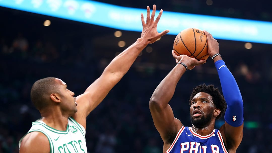 BOSTON, MA - OCTOBER 14:  Joel Embiid #21 of the Philadelphia 76ers shoots while guarded by Al Horford #42 of the Boston Celtics in the first quarter at TD Garden on October 16, 2018 in Boston, Massachusetts. NOTE TO USER: User expressly acknowledges and agrees that, by downloading and or using this photograph, User is consenting to the terms and conditions of the Getty Images License Agreement. (Photo by Adam Glanzman/Getty Images)