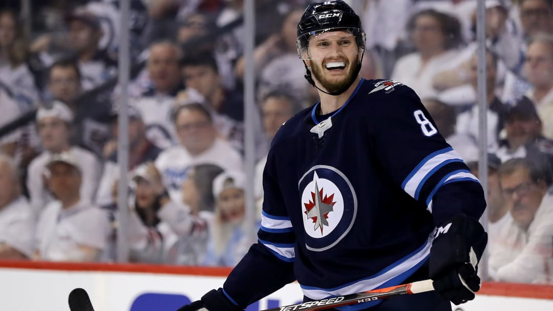 WINNIPEG, MB - MAY 12:  Jacob Trouba #8 of the Winnipeg Jets reacts after he is called for cross checking against the Vegas Golden Knights in Game One of the Western Conference Finals during the 2018 NHL Stanley Cup Playoffs at Bell MTS Place on May 12, 2018 in Winnipeg, Canada.  (Photo by Elsa/Getty Images)