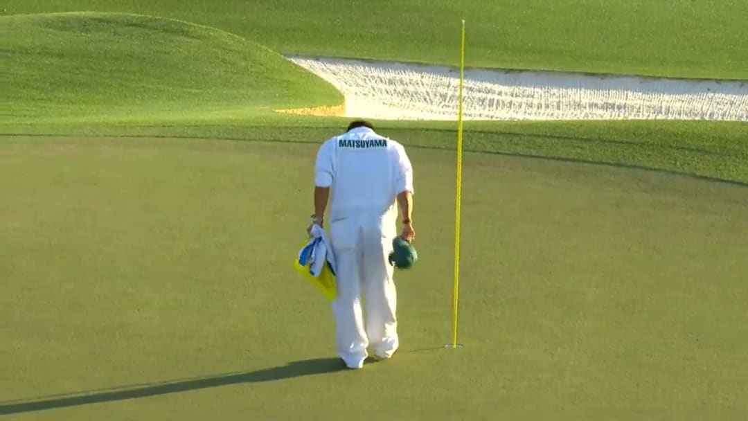 Shota Hayafuji bows to the course after Hideki Matsuyama wins the Masters