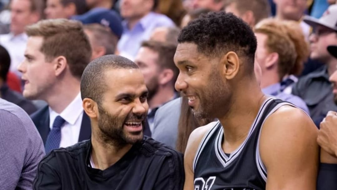 Feb 25, 2016; Salt Lake City, UT, USA; San Antonio Spurs guard Tony Parker (L) and center Tim Duncan (21) sit on the bench late in the second half against the Utah Jazz at Vivint Smart Home Arena. San Antonio won 96-78. Mandatory Credit: Russ Isabella-USA TODAY Sports