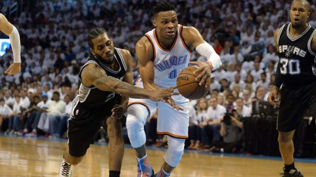 May 8, 2016; Oklahoma City, OK, USA; Oklahoma City Thunder guard Russell Westbrook (0) drives to the basket in front of San Antonio Spurs forward Kawhi Leonard (2) during the first quarter in game four of the second round of the NBA Playoffs at Chesapeake Energy Arena. Mandatory Credit: Mark D. Smith-USA TODAY Sports