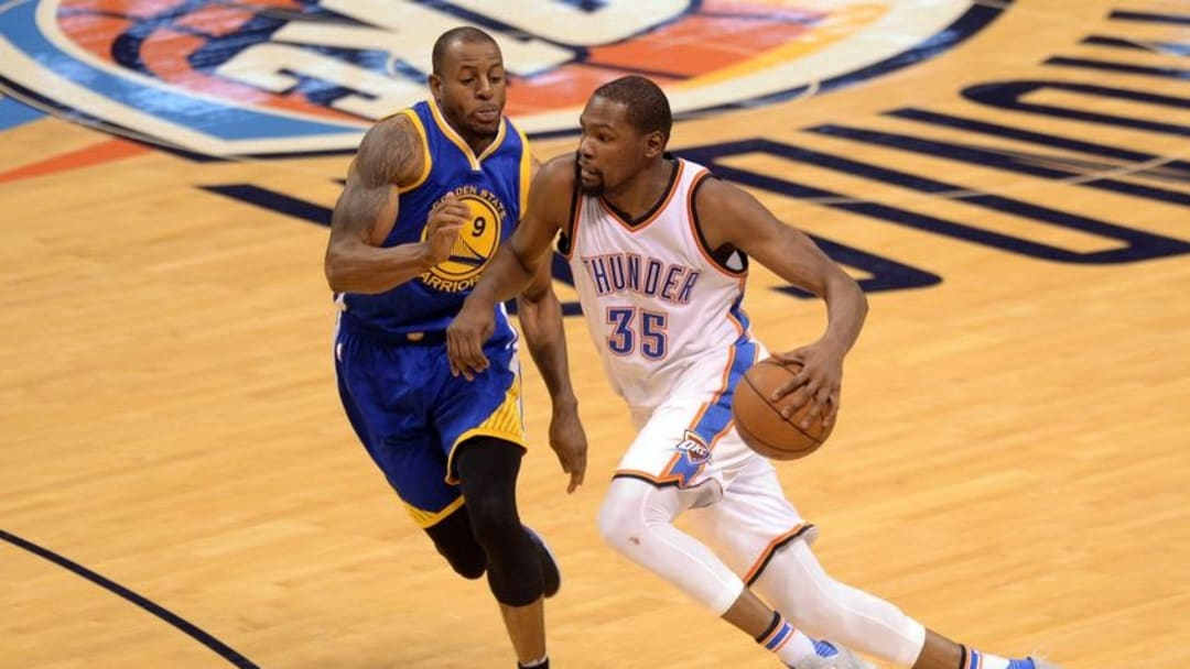 May 28, 2016; Oklahoma City, OK, USA; Oklahoma City Thunder forward Kevin Durant (35) handles the ball in front of Golden State Warriors forward Andre Iguodala (9) during the fourth quarter in game six of the Western conference finals of the NBA Playoffs at Chesapeake Energy Arena. Mandatory Credit: Mark D. Smith-USA TODAY Sports