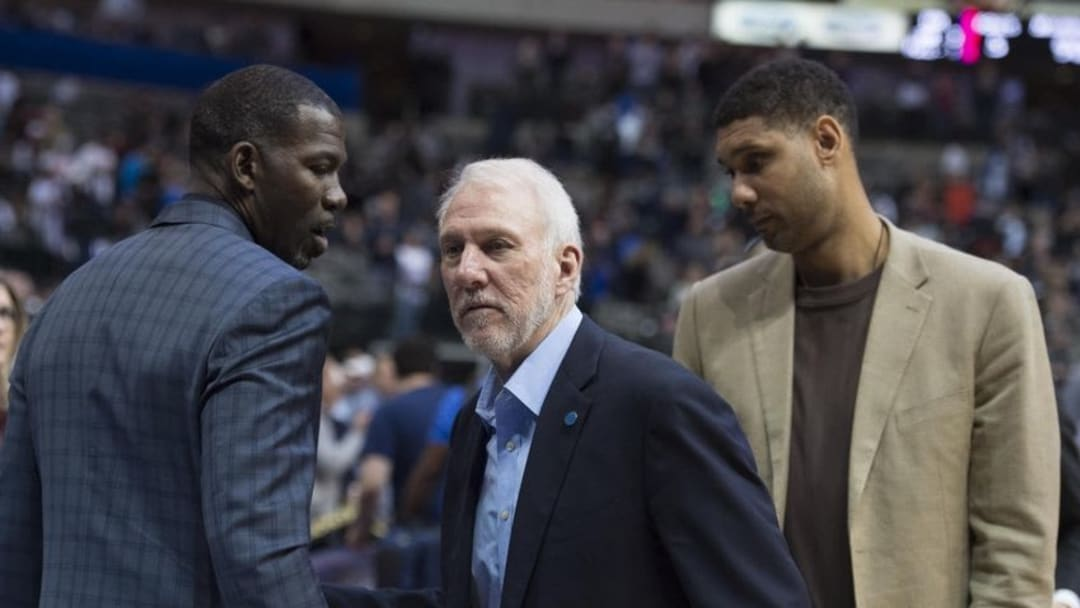 Feb 5, 2016; Dallas, TX, USA; San Antonio Spurs head coach Gregg Popovich and center Tim Duncan (21) talk with former Spurs player Michael Finley after the game against the Dallas Mavericks at the American Airlines Center. The Spurs defeat the Mavericks 116-90. Mandatory Credit: Jerome Miron-USA TODAY Sports