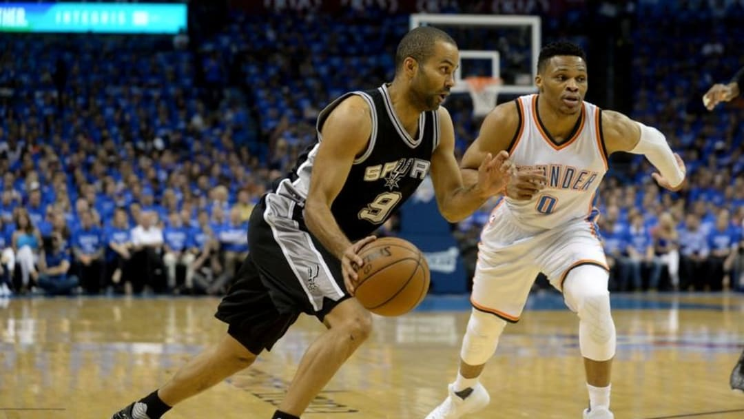 May 12, 2016; Oklahoma City, OK, USA; San Antonio Spurs guard Tony Parker (9) drives to the basket in front of Oklahoma City Thunder guard Russell Westbrook (0) during the second quarter in game six of the second round of the NBA Playoffs at Chesapeake Energy Arena. Mandatory Credit: Mark D. Smith-USA TODAY Sports