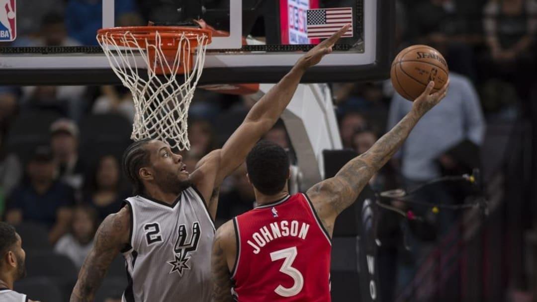 Apr 2, 2016; San Antonio, TX, USA; San Antonio Spurs forward Kawhi Leonard (2) defends against Toronto Raptors forward James Johnson (3) during the first quarter at the AT&T Center. Mandatory Credit: Jerome Miron-USA TODAY Sports