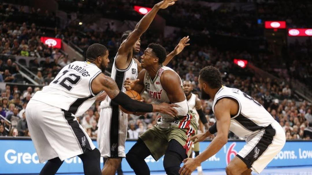 Nov 14, 2016; San Antonio, TX, USA; San Antonio Spurs power forward LaMarcus Aldridge (12), and Kawhi Leonard (2, rear) and Patty Mills (8, right) combine to strip the ball from Miami Heat center Hassan Whiteside (21) during the second half at AT&T Center. Mandatory Credit: Soobum Im-USA TODAY Sports