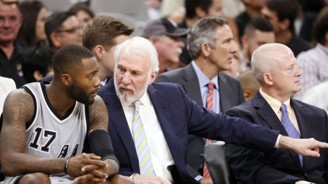 Oct 29, 2016; San Antonio, TX, USA; San Antonio Spurs head coach Gregg Popovich and guard Jonathon Simmons (17) talk on the bench during the second half against the New Orleans Pelicans at AT&T Center. Mandatory Credit: Soobum Im-USA TODAY Sports
