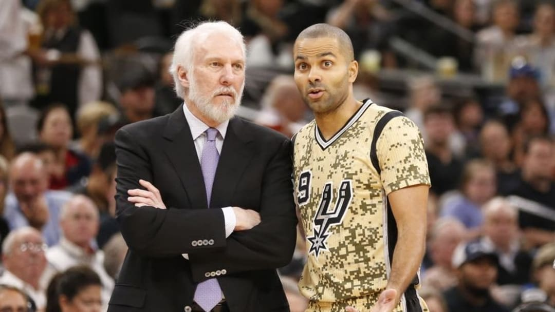 Nov 11, 2016; San Antonio, TX, USA; San Antonio Spurs head coach Gregg Popovich talks with guard Tony Parker (9) during the first half against the Detroit Pistons at AT&T Center. Mandatory Credit: Soobum Im-USA TODAY Sports