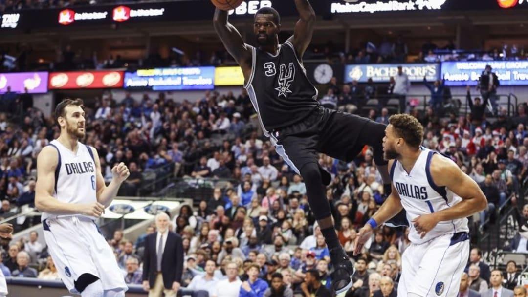 Nov 30, 2016; Dallas, TX, USA; San Antonio Spurs center Dewayne Dedmon (3) dunks over Dallas Mavericks guard Justin Anderson (1) during the second half at American Airlines Center. Mandatory Credit: Kevin Jairaj-USA TODAY Sports