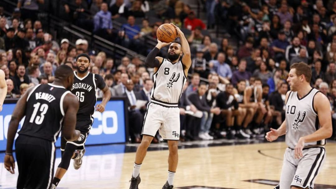 Dec 10, 2016; San Antonio, TX, USA; San Antonio Spurs point guard Patty Mills (8) shoots the ball against the Brooklyn Nets during the second half at AT&T Center. Mandatory Credit: Soobum Im-USA TODAY Sports