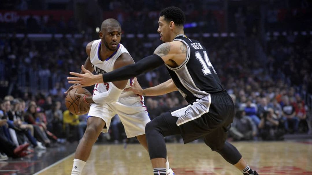 December 22, 2016; Los Angeles, CA, USA; Los Angeles Clippers guard Chris Paul (3) controls the ball against San Antonio Spurs guard Danny Green (14) during the first half at Staples Center. Mandatory Credit: Gary A. Vasquez-USA TODAY Sports