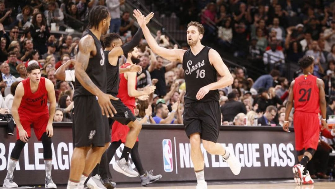 Dec 25, 2016; San Antonio, TX, USA; San Antonio Spurs center Pau Gasol (16) celebrates with teammate Patty Mills (8, left) after a basket during the first half against the Chicago Bulls at AT&T Center. Mandatory Credit: Soobum Im-USA TODAY Sports