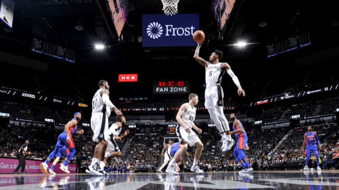 SAN ANTONIO, TX - OCTOBER 5: Dejounte Murray #5 of the San Antonio Spurs shoots the ball against the Detroit Pistons during a pre-season game on October 5, 2018 at the AT&T Center in San Antonio, Texas. NOTE TO USER: User expressly acknowledges and agrees that, by downloading and or using this photograph, user is consenting to the terms and conditions of the Getty Images License Agreement. Mandatory Copyright Notice: Copyright 2018 NBAE (Photos by Mark Sobhani/NBAE via Getty Images)