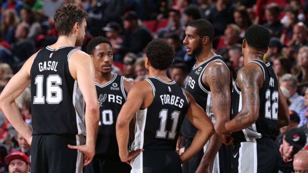 The San Antonio Spurs huddle up against the Portland Trail Blazers (Photo by Sam Forencich/NBAE via Getty Images)