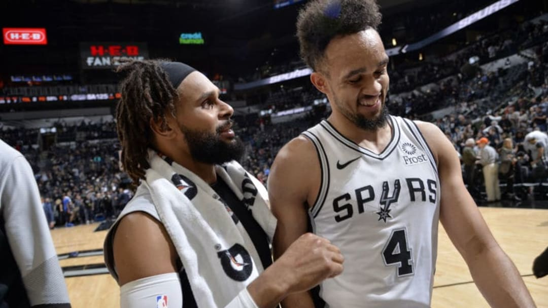SAN ANTONIO, TX - DECEMBER 13: Patty Mills #8 of the San Antonio Spurs and Derrick White #4 talk during the game against the LA Clippers on December 13, 2018 at the AT&T Center in San Antonio, Texas. NOTE TO USER: User expressly acknowledges and agrees that, by downloading and or using this photograph, user is consenting to the terms and conditions of the Getty Images License Agreement. Mandatory Copyright Notice: Copyright 2018 NBAE (Photos by Mark Sobhani/NBAE via Getty Images)