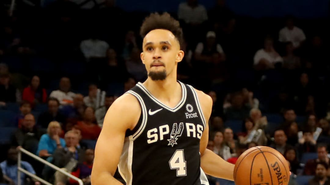 ORLANDO, FLORIDA - DECEMBER 19: Derrick White #4 of the San Antonio Spurs sets up the offense during the game against the Orlando Magic at Amway Center on December 19, 2018 in Orlando, Florida. NOTE TO USER: User expressly acknowledges and agrees that, by downloading and or using this photograph, User is consenting to the terms and conditions of the Getty Images License Agreement. (Photo by Sam Greenwood/Getty Images)
