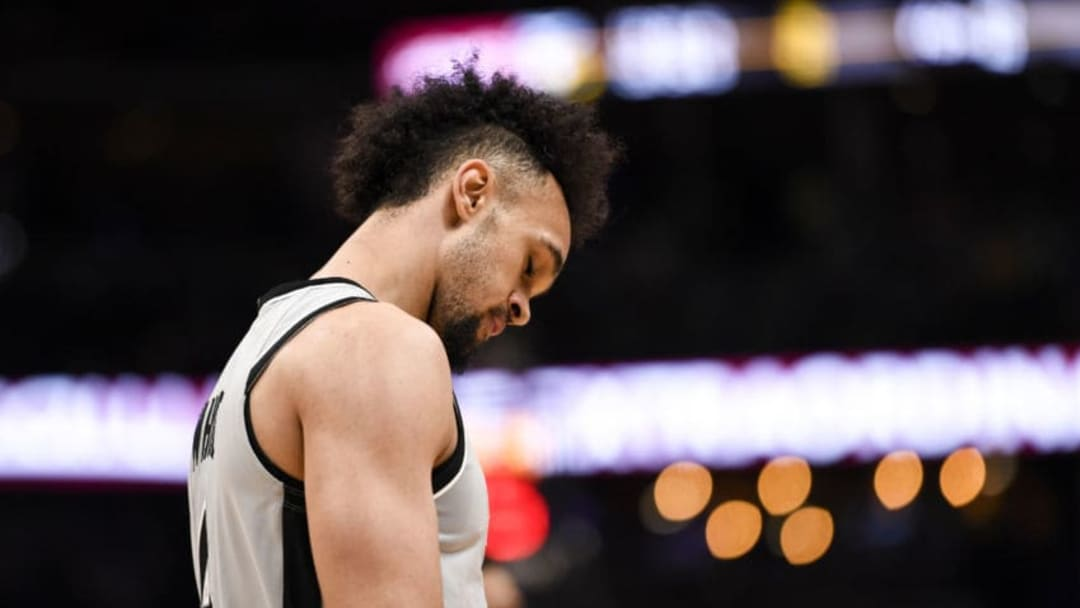 DENVER, CO - APRIL 27: Derrick White (4) of the San Antonio Spurs reacts to fouling Jamal Murray (27) of the Denver Nuggets during the third quarter of game seven on Saturday, April 27, 2019. The Denver Nuggets and the San Antonio Spurs game seven of their first round NBA playoff series. (Photo by AAron Ontiveroz/MediaNews Group/The Denver Post via Getty Images)