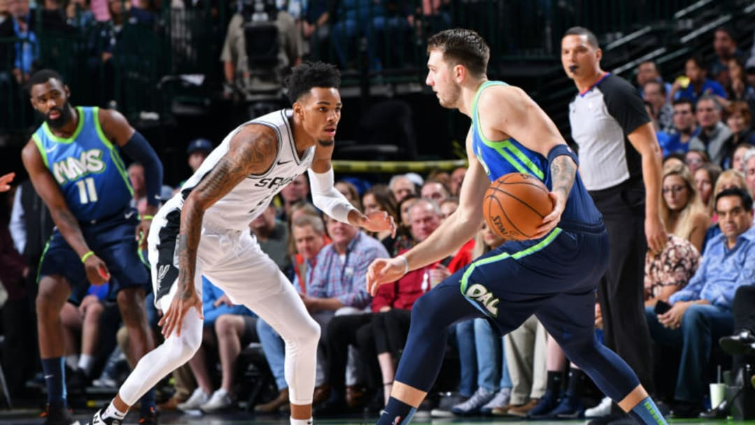 Luka Doncic of the Dallas Mavericks dribbles the ball while Dejounte Murray of the San Antonio Spurs plays defense. (Photo by Glenn James/NBAE via Getty Images)
