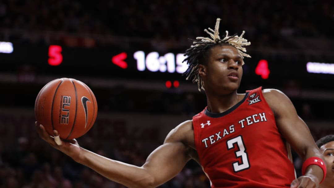 AMES, IA - FEBRUARY 22: NBA Draft prospect Jahmi'us Ramsey #3 of the Texas Tech Red Raiders passes the ball in the first half of the play at Hilton Coliseum. He should be on the San Antonio Spurs radar. (Photo by David K Purdy/Getty Images)