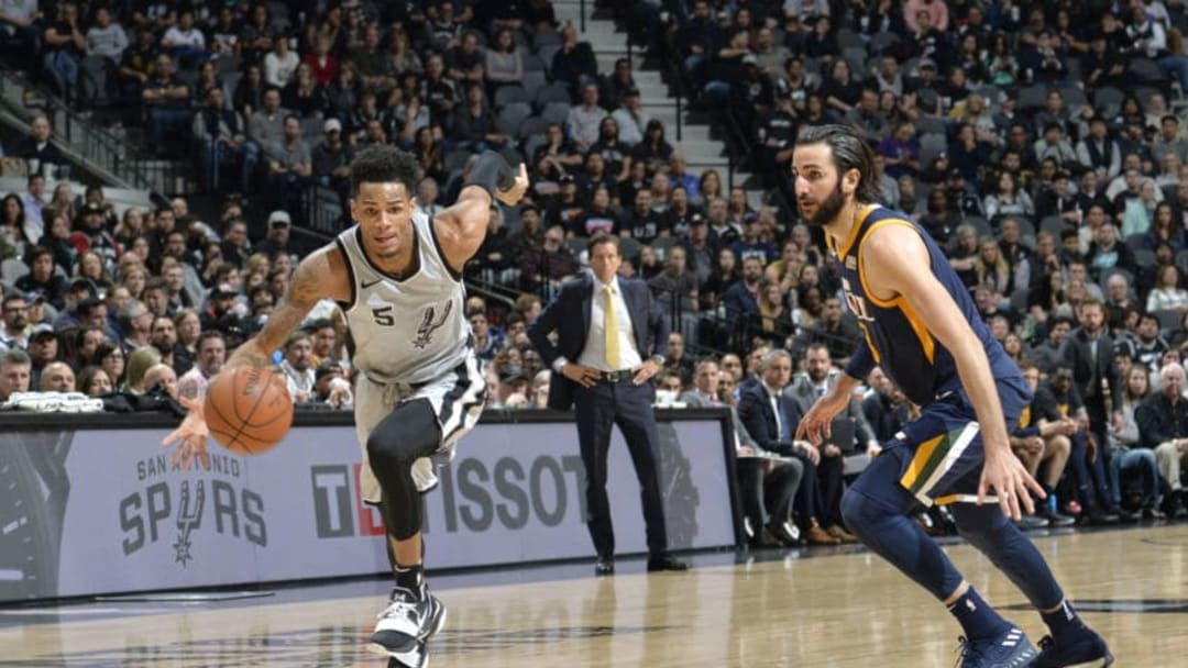 SAN ANTONIO, TX - FEBRUARY 3: Dejounte Murray #5 of the San Antonio Spurs handles the ball against Ricky Rubio #3 of the Utah Jazz on February 3, 2018 at the AT&T Center in San Antonio, Texas. NOTE TO USER: User expressly acknowledges and agrees that, by downloading and or using this photograph, user is consenting to the terms and conditions of the Getty Images License Agreement. Mandatory Copyright Notice: Copyright 2018 NBAE (Photos by Mark Sobhani/NBAE via Getty Images)