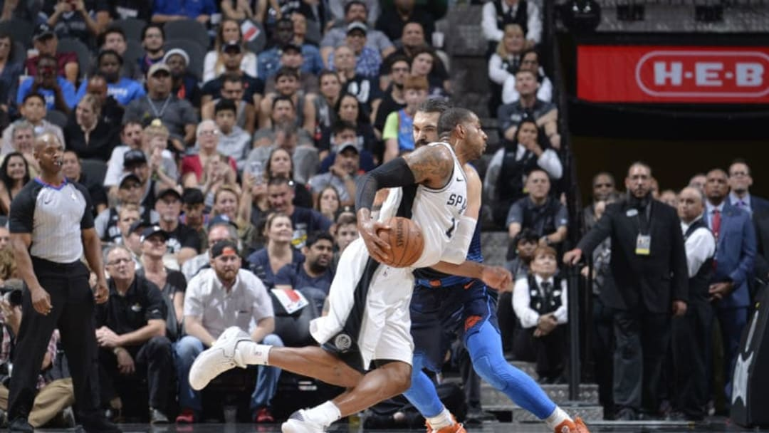 SAN ANTONIO, TX - MARCH 29: LaMarcus Aldridge #12 of the San Antonio Spurs handles the ball against the Oklahoma City Thunder on March 29, 2018 at the AT&T Center in San Antonio, Texas. NOTE TO USER: User expressly acknowledges and agrees that, by downloading and or using this photograph, user is consenting to the terms and conditions of the Getty Images License Agreement. Mandatory Copyright Notice: Copyright 2018 NBAE (Photos by Mark Sobhani/NBAE via Getty Images)