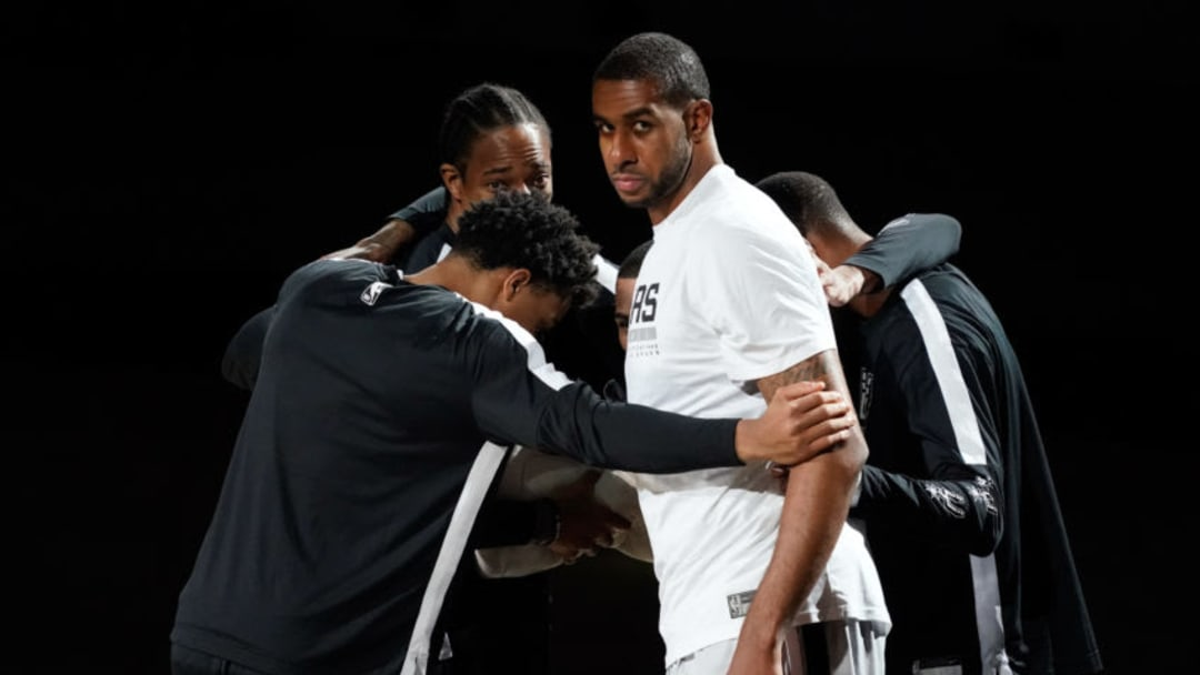 Jan 27, 2021; San Antonio, Texas, USA; San Antonio Spurs forward LaMarcus Aldridge (12) in huddle with starters before the game against the Boston Celtics at AT&T Center. Mandatory Credit: Scott Wachter-USA TODAY Sports