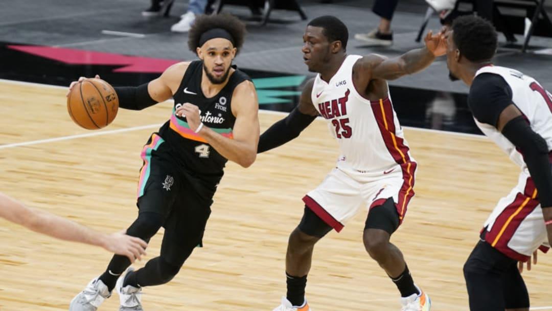 Apr 21, 2021; San Antonio, Texas, USA; San Antonio Spurs guard Derrick White (4) controls the ball against Miami Heat guard Kendrick Nunn (25) in the second quarter at AT&T Center. Mandatory Credit: Scott Wachter-USA TODAY Sports