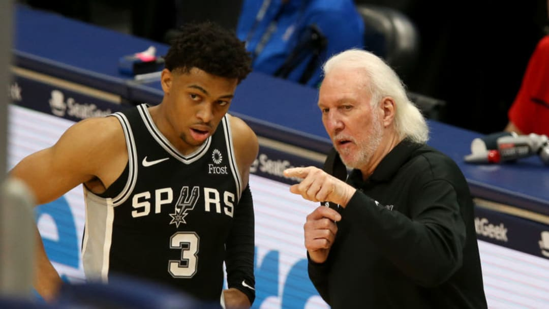 Apr 24, 2021; New Orleans, Louisiana, USA; San Antonio Spurs forward Keldon Johnson (3) talks to head coach Gregg Popovich during the third quarter against the New Orleans Pelicans at the Smoothie King Center. Mandatory Credit: Chuck Cook-USA TODAY Sports