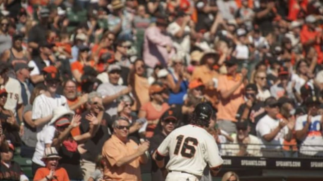 Oct 4, 2015; San Francisco, CA, USA; The San Francisco Giants fans cheer for center fielder Angel Pagan (16) after he scored against the Colorado Rockies during the first inning at AT&T Park. Mandatory Credit: Ed Szczepanski-USA TODAY Sports