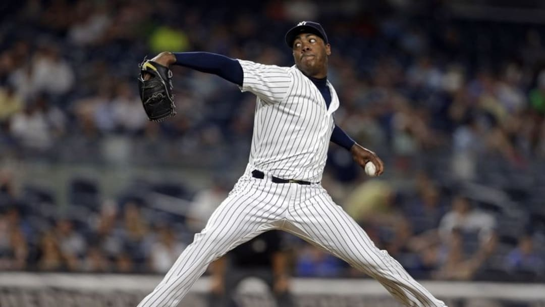 Jul 18, 2016; Bronx, NY, USA; New York Yankees relief pitcher Aroldis Chapman (54) pitches against the Baltimore Orioles during the ninth inning at Yankee Stadium. Mandatory Credit: Adam Hunger-USA TODAY Sports