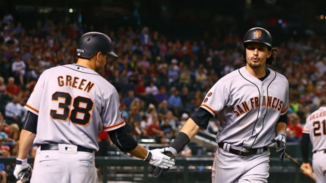 Jul 1, 2016; Phoenix, AZ, USA; San Francisco Giants outfielder Jarrett Parker (right) is congratulated by Grant Green after hitting a solo home run in the eighth inning against the Arizona Diamondbacks at Chase Field. Mandatory Credit: Mark J. Rebilas-USA TODAY Sports