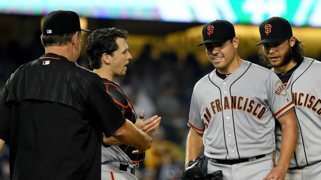 Aug 25, 2016; Los Angeles, CA, USA; San Francisco Giants catcher Buster Posey (28) and shortstop Brandon Crawford (35) look on as starting pitcher Matt Moore (45) is taken out of the game by manager Bruce Bochy (15) as he came up one out short of a no hitter giving up a single to Los Angeles Dodgers shortstop Corey Seager (5) in the ninth inning of the game at Dodger Stadium. Mandatory Credit: Jayne Kamin-Oncea-USA TODAY Sports