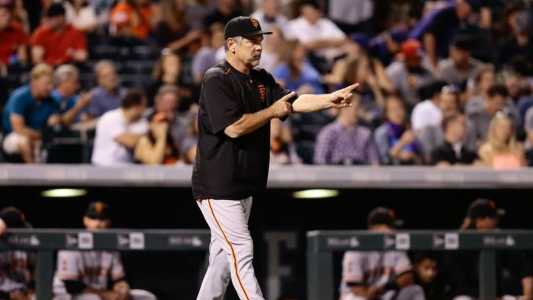 Sep 7, 2016; Denver, CO, USA; San Francisco Giants manager Bruce Bochy (15) signals in the eighth inning against the Colorado Rockies at Coors Field. Mandatory Credit: Isaiah J. Downing-USA TODAY Sports