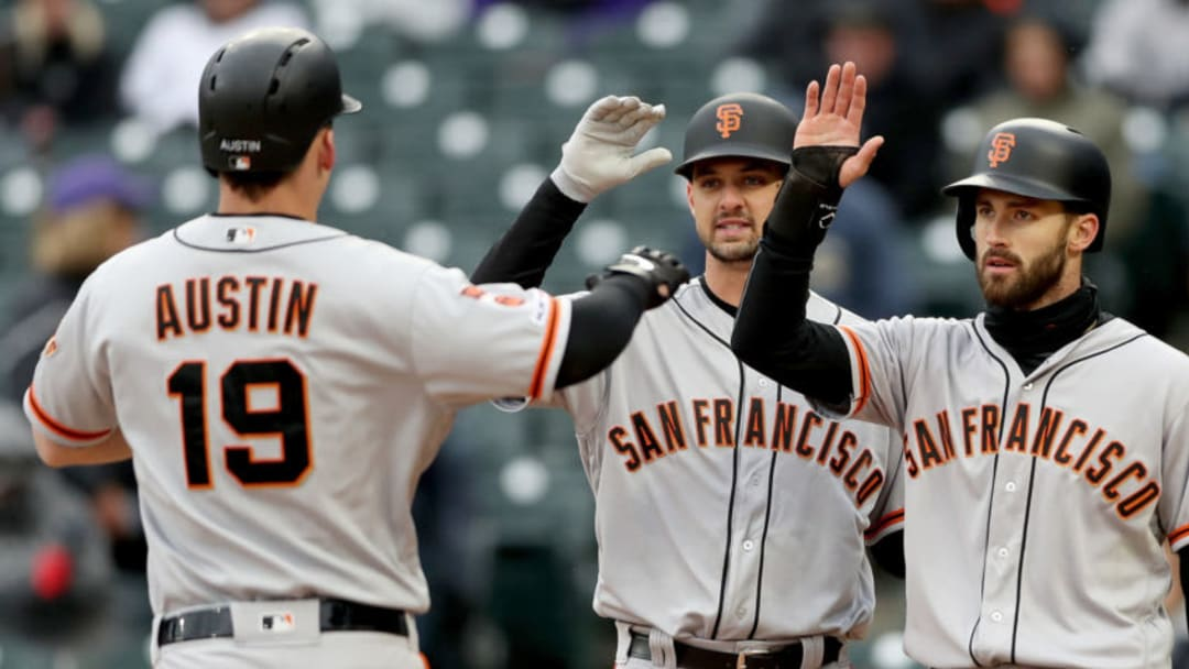 DENVER, COLORADO - MAY 09: Tyler Austin #19 of the San Francisco Giants is met at the plate by Tyler Beede #38 and Steven Duggar #6 after hitting a 3 RBI home run in the sixth inning against the Colorado Rockies at Coors Field on May 08, 2019 in Denver, Colorado. (Photo by Matthew Stockman/Getty Images)